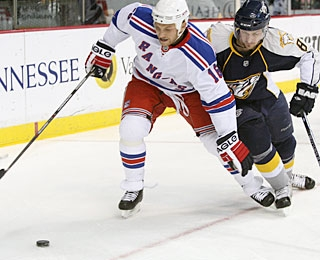 Sean Avery's positive impact continues as he scores his first goal since returning to the Rangers. (AP)