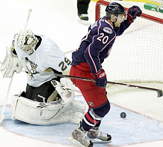 Marc-Andre Fleury tries to figure out where the puck is, while Kristian Huselius knows it's in the net. (AP)