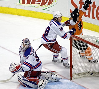 Arron Asham beats Henrik Lundqvist after a perfect feed by Claude Giroux from behind the net. (AP)