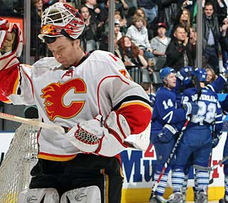 Flames goalie Miikka Kiprusoff has a very long night, allowing six goals before being pulled.  (Getty Images)