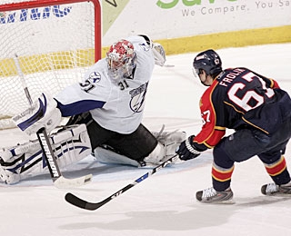 Karri Ramo uses his blocker to stop Michael Frolik, the last shooter for the Panthers. (Getty Images)