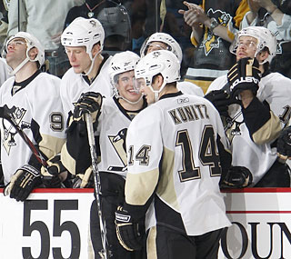 Although Chris Kunitz loses his hat trick, he still helps his Penguins pull out a crucial win.  (Getty Images)