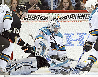 The Ducks have no luck against goalie Evgeni Nabokov, who stops 34 shots in the playoff-clinching win.  (AP)