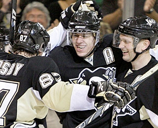 Sidney Crosby (87) says of Evgeni Malkin, 'Everything he touches, he makes something happen.' (AP)