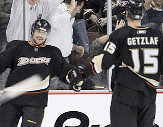 Ryan Getzlaf is the first to reach Teemu Selanne, who scores his 22nd goal and the winner. (AP)