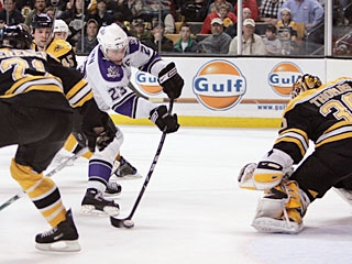Dustin Brown picks up a rebound in the slot and caps the comeback for the visiting Kings. (AP)