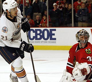 The Oilers' Ales Kotalik beats Blackhawks goalie Nikolai Khabibulin in the shootout.  (AP)