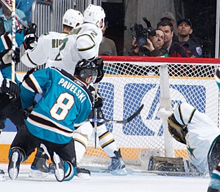 Joe Pavelski wastes no time to trigger a quick shot when the puck bounces in the slot. (Getty Images)