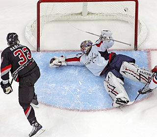 After scoring two goals against the Devils, Anton Babchuk puts one in versus the Caps, too. (AP)