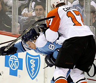 Jeff Carter knocks Sidney Crosby off the puck as the Flyers stifle Pittsburgh's stars.  (AP)
