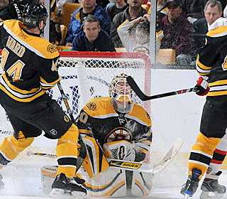 Tim Thomas makes one of his 41 saves to help the Bruins capture their 102nd point.  (Getty Images)