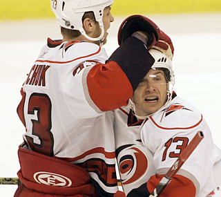 Anton Babchuk embraces Ray Whitney, who scores the winning goal in overtime for the Hurricanes.  (AP)