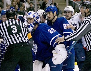 An upset Martin Gerber (29) confronts and pushes referee Mike Leggo (3) after a controversial goal. (AP)