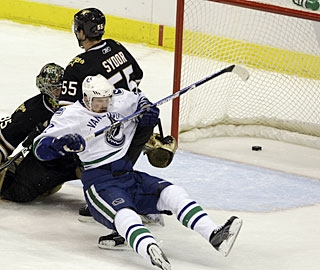Daniel Sedin takes a hard fall after scoring Vancouver's go-ahead goal on the power play. (AP)