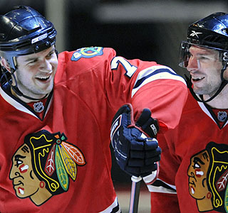 Brent Seabrook (left) celebrates with Troy Brouwer following Seabrook's game-winning goal.  (AP)