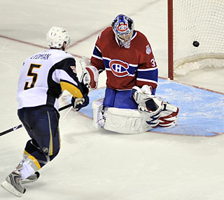 Buffalo's Toni Lydman beats Carey Price in the shootout to give the Sabres the win.  (AP)