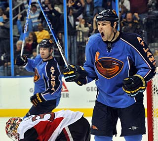 Marty Reasoner (right) celebrates his goal in the second period against the Senators.  (AP)