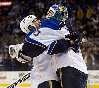 Goalie Chris Mason and Dan Hinote embrace as the Blues keep up in the playoff hunt.  (Getty Images)