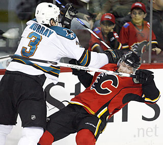 Douglas Murray and the Sharks push aside the Flames to reach the 50-win plateau for a second time.  (AP)