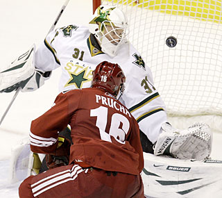 Petr Prucha sends the puck past goalie Tobias Stephan in overtime to propel the Coyotes to victory.  (AP)