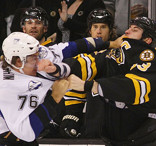 Tampa Bay's Evgeny Artyukhin and Boston's Zdeno Chara exchange a few blows.  (Getty Images)