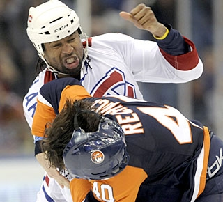 Joel Rechlicz is advertised as an enforcer but the wily Georges Laraque is not easy on the rookie. (AP)