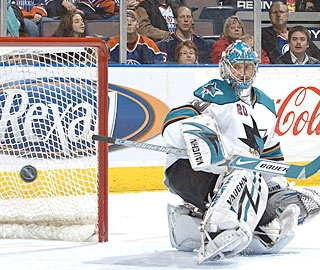 Evgeni Nabokov uses his blocker for one of his saves to improve to an impressive 40-9-8. (Getty Images)