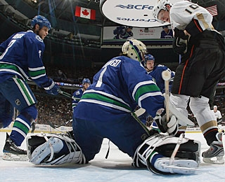 Corey Perry (10) troubles Roberto Luongo during early action before beating him in the SO.  (Getty Images)