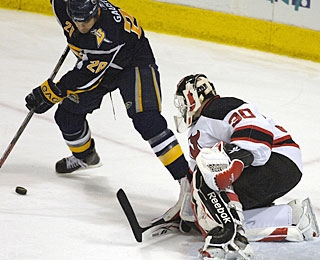 Martin Brodeur is bombarded with 23 shots in the third period, stopping 21 of them to hold for the win. (AP)
