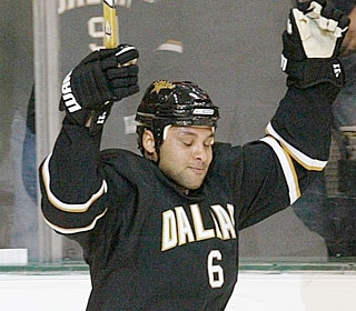 Trevor Daley celebrates his winning goal just 16 seconds after the start of overtime. (AP)