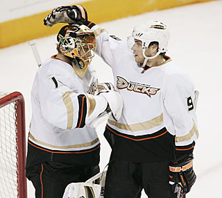 Bobby Ryan congratulates goalie Jonas Hiller, who makes 28 saves against San Jose.  (AP)