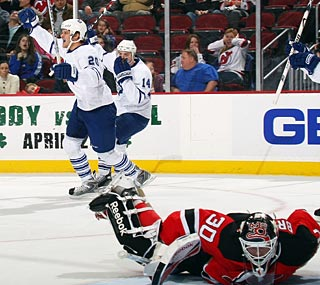 Christian Hanson (20) can brag about scoring his first career goal against  Martin Brodeur. (Getty Images)