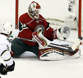 Niklas Backstrom stops a Mike Modano shot for one of his 27 saves during the Wild's victory.  (AP)