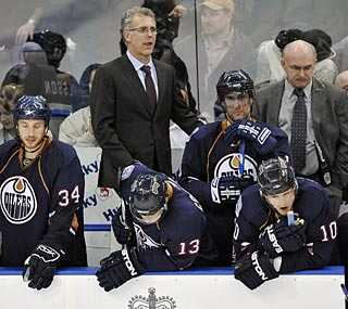The Oilers lament their loss and would soon find out their playoff hopes would be dashed, too.  (AP)