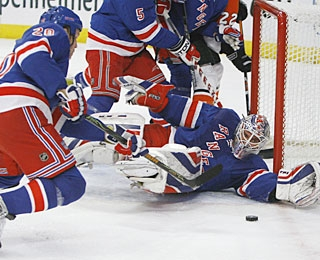 Henrik Lundqvist stops 37 shots to collect 37 wins for the third time in his career. (AP)