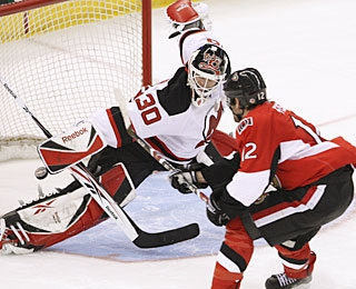 Martin Brodeur plays his part in helping the Devils win a franchise-best 50th game. (AP)