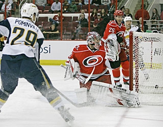 It's a tough angle, but Jason Pominville's shot finds a way past Cam Ward for the first of his two goals. (AP)