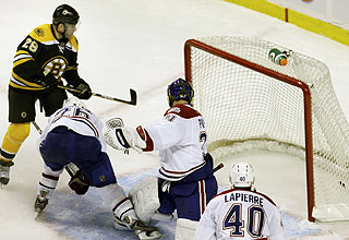 Boston's Mark Recchi slips the winning goal past Carey Price in overtime. (AP)