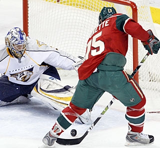 Andrew Brunette, who has two teeth knocked out by a puck, is one of seven scorers for the Wild. (AP)