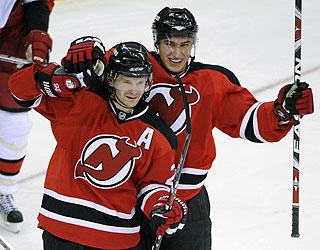 Patrik Elias and Dainius Zubrus enjoy a victory in the Devils' final regular-season game. (AP)