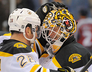 Goalie Tim Thomas (32 saves) enjoys the win as it represents his 36th of the season.  (US Presswire)