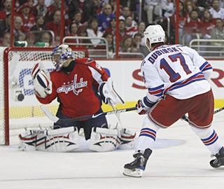 Brandon Dubinsky finds more than enough space to beat Jose Theodore at the near post. (AP)