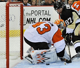 Sidney Crosby (87) is credited with a goal even though the puck goes in off his skate. (Getty Images)