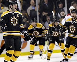 All the Bruins chase captain Zdeno Chara (left), who drills the go-ahead goal on the power play. (AP)