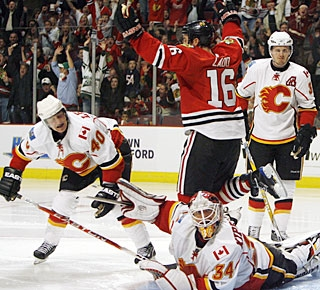 Miikka Kiprusoff looks to the ref for a goalie interference on Andrew Ladd, but does not get it. (AP)