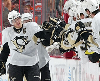 It's not the prettiest goal Sidney Crosby ever scores, but the bench celebrates it just the same. (AP)