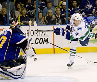 Alex Burrows takes a fast rush on the right side and squeezes a wrister for the winner. (Getty Images)