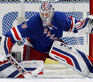 Henrik Lundqvist finishes with 38 saves for the Rangers, who can clinch the series on Friday.  (AP)
