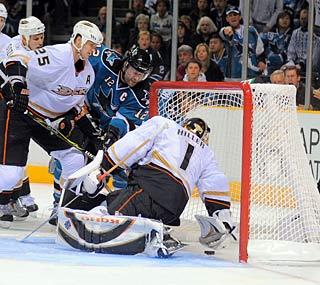 Patrick Marleau's persistence pays off as the puck trickles into the net in overtime.  (US Presswire)