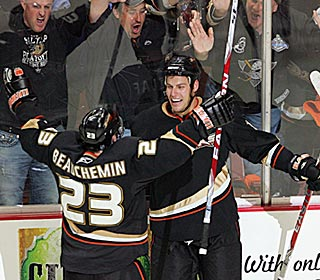 It's pandemonium after Ryan Getzlaf (right) scores late in the game to put the series on ice.